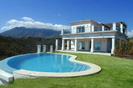 An impressive luxury hillside villa with superb sea and country views, Estepona