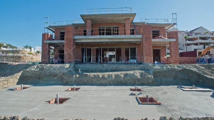 Stage 7: Exterior walls and roof complete, work on the interior and pool begins